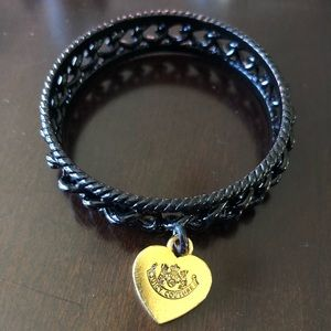 Juicy Couture black bangle with gold charm